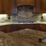 Finished kitchen with granite countertops and custom cabinetry